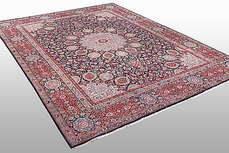 A carpet, semi-antique/old meshed, ca 407 x 305 cm.