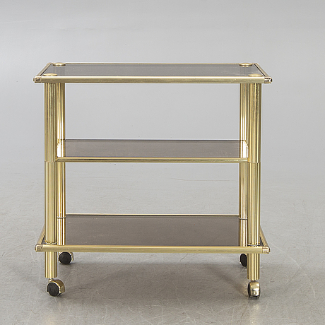 A brass serving trolley later part of the 20th century.