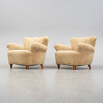 A pair of Swedish shearling easy chairs, 1940s.