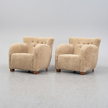 A pair of shearling easy chairs, attributed to Thorald Madsen, Thorald Madsen Snedkeri Denmark, 1940s.