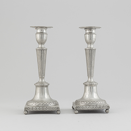 A pair of pewter candle stick by anjou, norrköping 1804.