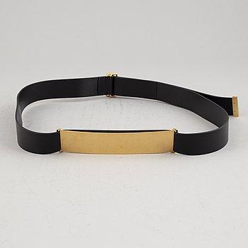 Céline, a black leather belt, size L.
