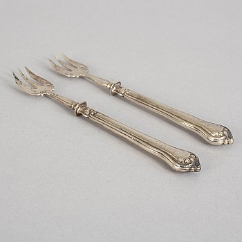 A set of twelve French 19th century silver oyster forks, mark of Hippolyte Thomas, Paris.