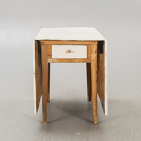 A painted gate legged table later part of the 19th century.