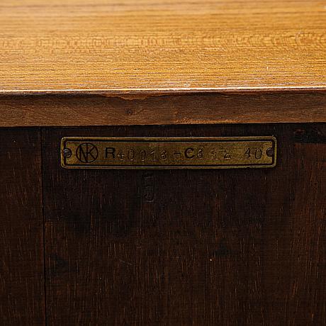 A bookshelf by axel einar hjorth for nordiska kompaniets verkstäder (nk), nyköping, late 1930's.
