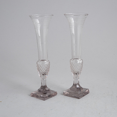 Two champagne glasses, first half of the 19th century, and a beaker, 20th century.
