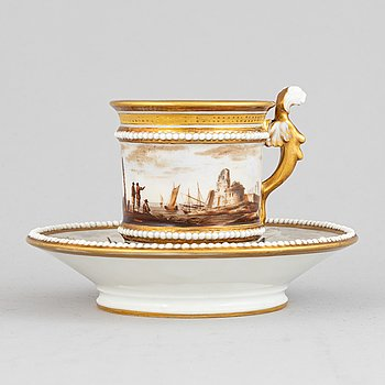 A porcelain cup with stand, Empire, 19th Century.