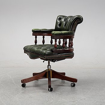 A leather upholstered mahogany office armchair, second half of the 20th Century.