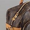 Louis vuitton, a monogram canvas carry on bag.
