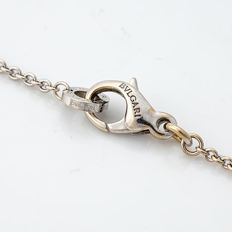 """A bulgari """"parentesi"""" pendant with a chain."""