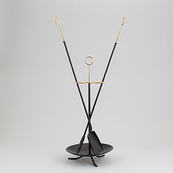 A fireplace stand of three parts by Gunnar Ander for Ystad Metall.
