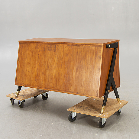 A mid 1900s teak counter.