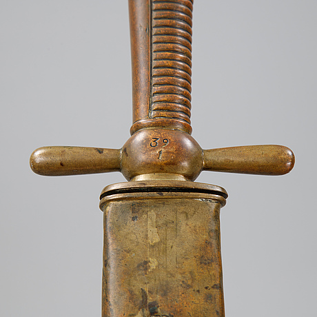 A mid 19th century cutlass with scabbard.