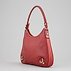 Gucci, a red leather handbag.