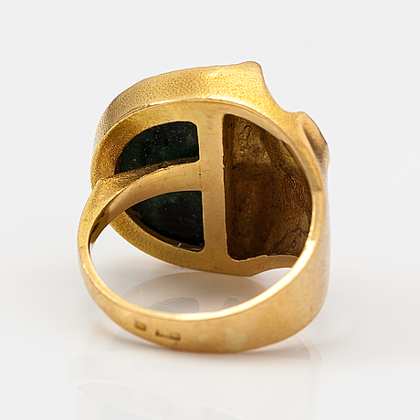 """Björn weckström, """"quebec"""" an 18k gold ring with a ca. 0.05 ct diamond and a zoisite. lapponia."""