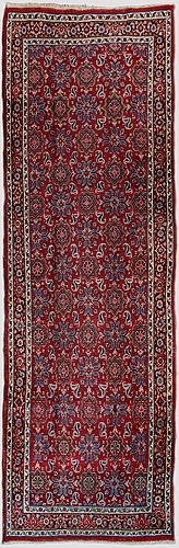 An oriental carpet. circa 407x126 cm.