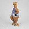 A stoneware figurine. 'dora', by lisa larson, gustavsberg, signed.