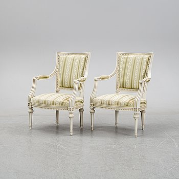 A pair of Gustavian style armchairs, 20th Century.