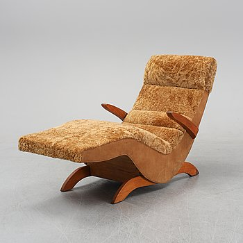 A rocking lounge chair, mid 20th Century.