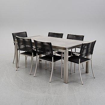 An aluminum and concrete table with six aluminum chairs, Kila Möbler, 21st Century.