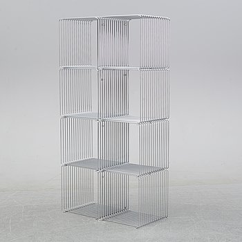 A 'Panton wire' shelving system by Verner Panton for Montana.
