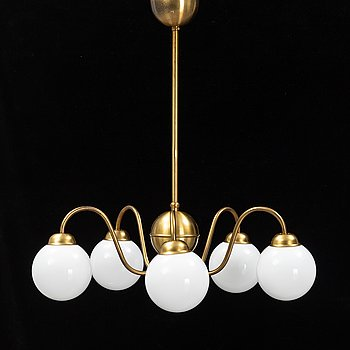 A mid 20th Century brass and glass ceiling light.