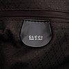 Gucci, a chocolate brown nylon handbag.