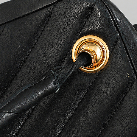 Chanel, a black leather handbag, 1980's.