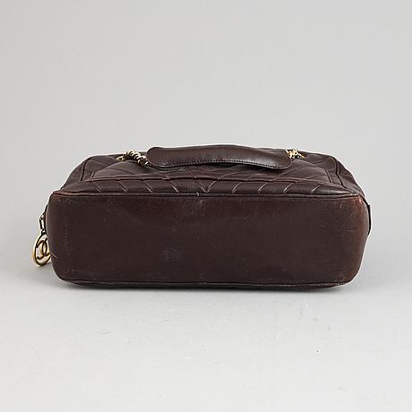 Chanel, a burgundy leather handbag, 1989-91.