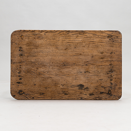 A wooden table, first half of the 19th century.