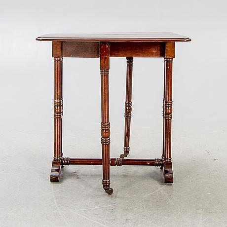 A 20th century english mahogany folding table.