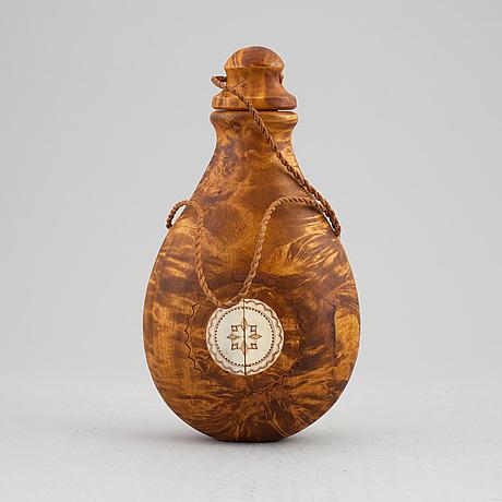 Anders sunna, a sami birch and reindeer horn salt flask, signed a. sunna.