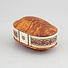 Esse poggats, a sami burr birch and reindeer horn box, signed and dated 77.