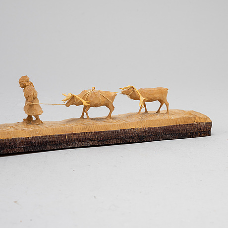 Kjell bergqvist, a sami carved birch sculpture, malmberget, signed kb and dated 75.