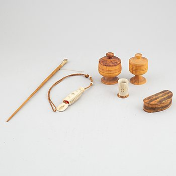 Six Sami birch and reindeer horn items.