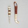 Sune enoksson, a reindeer horn sami knife, signed.