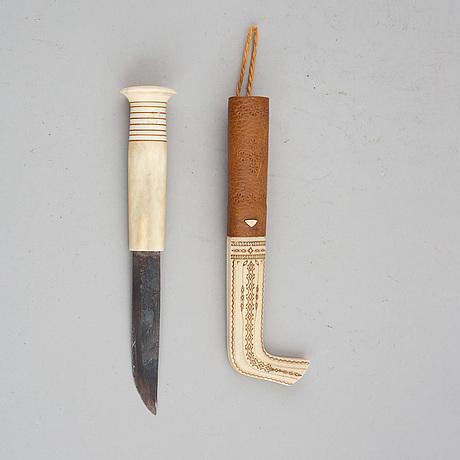 Per sunna, a sami rendeer horn knife, signed.