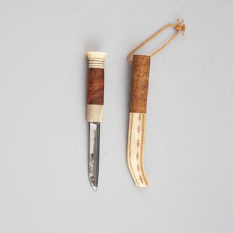 Lars levi sunna, a sami reindeer horn knife, signed.