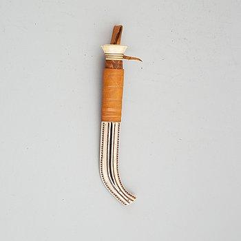Esse Poggats, a reindeer horn Sami knife, signed.