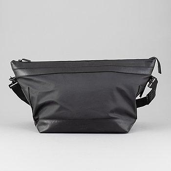 Dunhill, a black PVC weekendbag.