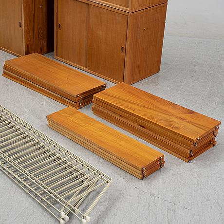 A 'string' teak veneered shelving system by nils strinning.