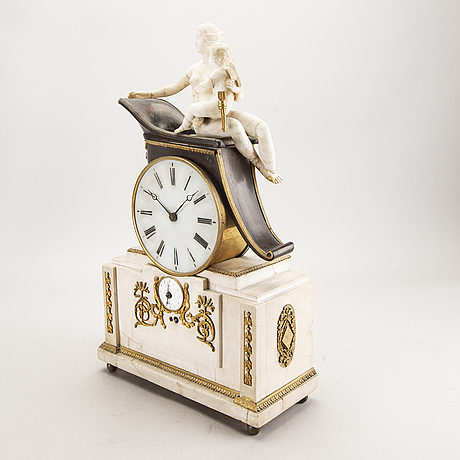 An empire table clock first half of the 19th century.