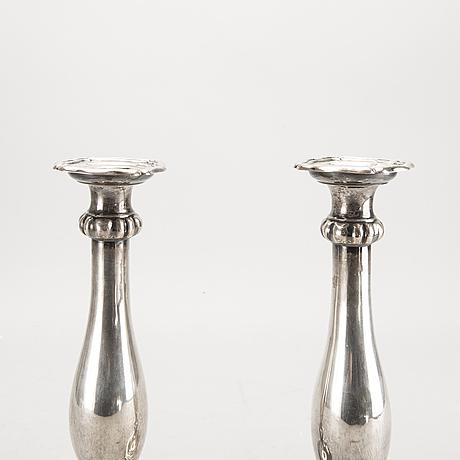 A pair of austrian silver candle sticks vienna 1852 weight 626 gr.