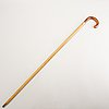 A wood cane with gold mounting with monogram i.k. (reportedly ivar kreuger).