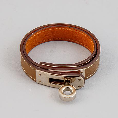Hermès, a taupe leather 'kelly double' bracelet, size xs, 2013.