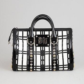 Versace, a black and white leather studded handbag.