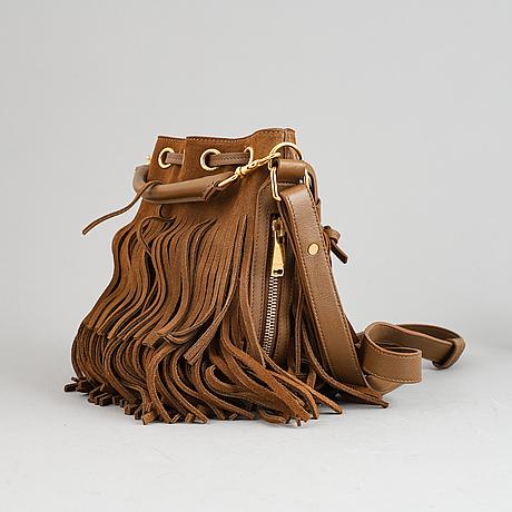 Yves saint laurent, a suede fringe handbag.