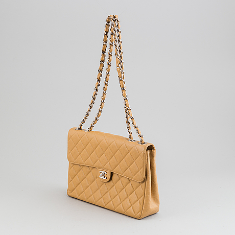Chanel, a  quilted caviar leather 'jumbo' bag, 2000-02.