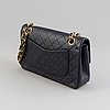 Chanel, a navy leather 'double flap bag', 1989-91.