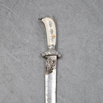 An 18th Century hunting sword with ivory handle.
